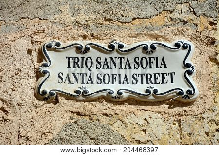 Triq Santa Sofia which translates as Santa Sofia Street sign Mdina Malta Europe.