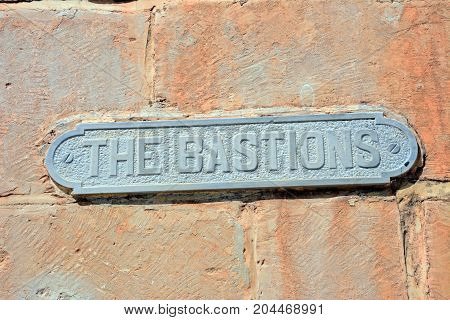 The Bastions street sign on a limestone wall Mdina Malta Europe.