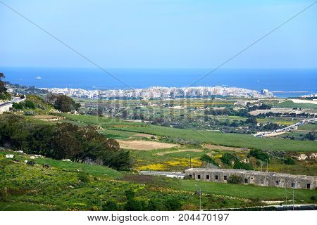 Elevated view of farmland looking North towards the coast Mdina Malta Europe.