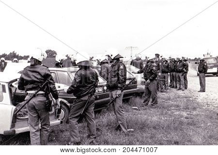 GERWISCH, GERMANY - May 23, 1994: German policemen arrest skinheads on a campground in Gerwisch, Saxony Anhalt 1994.