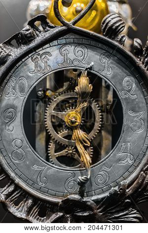 Old clock closeup made out of steel and metal