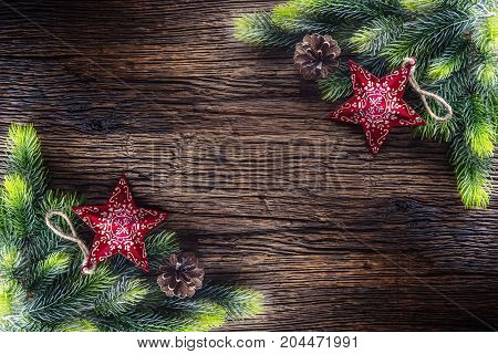 Christmas. Christmas Fir Tree With Star And  Pine Cone On Rustic Wooden Table. Diagonally Compositio