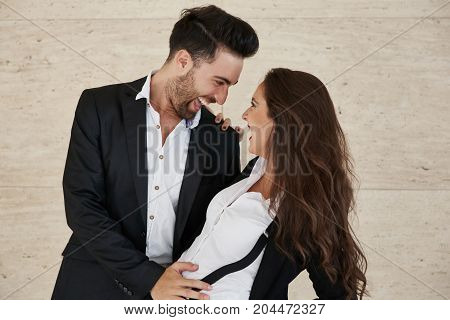 Happy Businessman Holding His Girlfriend Laughing