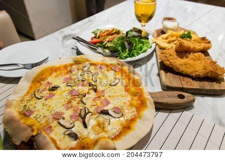 delicious fish and chips ham pizza and spicy salmon salad