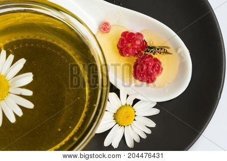 Honey On White Background In Jar, Glass. Chamomile, Raspberry.