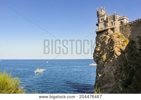 Castle on a rocky shore. Small Castle Lastochkino Nest and its surroundings.