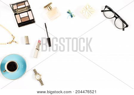 Fashion blogger objects flat lay. Beauty products, tea cup and stylish female accessories on white background, top view.