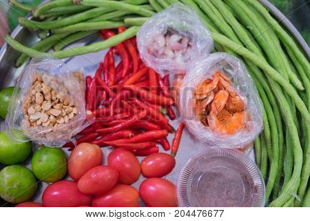 Spicy papaya Som Tam salad ingredients. Thai spicy food