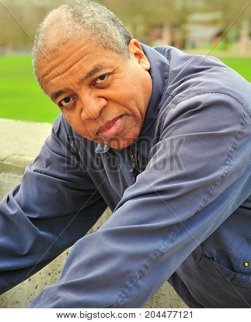 African american male senior expressions in a public park outdoors.