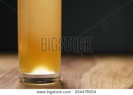 wheat unfiltered beer poured into glass on wood board, with copy space
