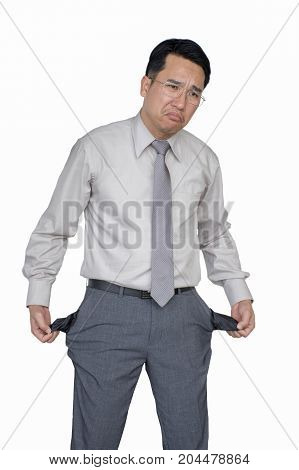 Asian businessman turning his empty pockets inside out, Poor businessman showing empty pants pockets isolated on white background, Concept of bankruptcy.
