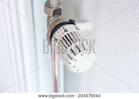 White Thermostat Of A Heating Set On High