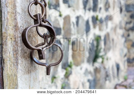 Medieval Prison Chains For Prisoners In Front Of Stone Wall