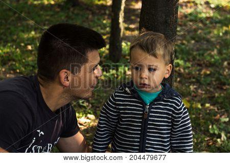 father and son a facial expression autumn