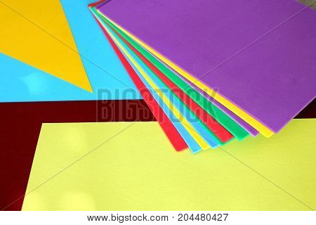 Colored sheets of paper thrown in disorder Holiday of colors