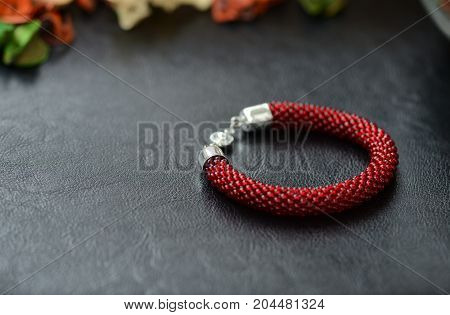 Bead Crochet Bracelet Dark Red Color On A Dark Background