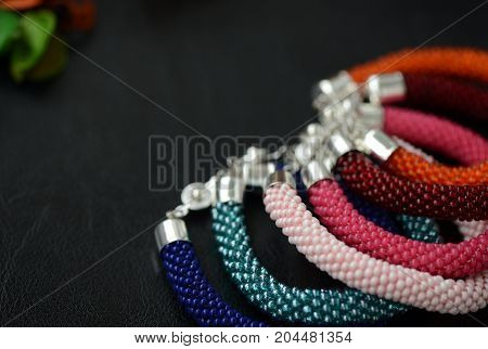 Bead Crochet Bracelets Different Colors On A Dark Background