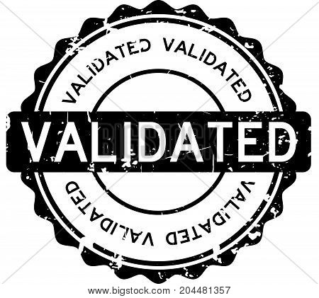 Grunge black validated wording round rubber seal stamp on white background