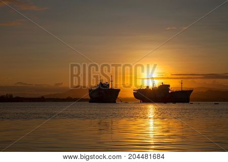 big transport boats in the morning sunrise .