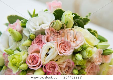 Gold Wedding Rings And Flowers