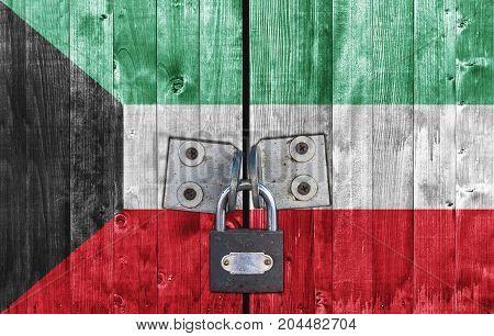 Kuwait flag on door with padlock close