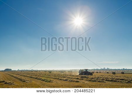 Yellow Field With Straw Bales During Harvesting On A Sunny Day In Normandy, France. Country Landscap
