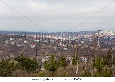 City view with cloudy sky.  Photo can be used as a whole background.