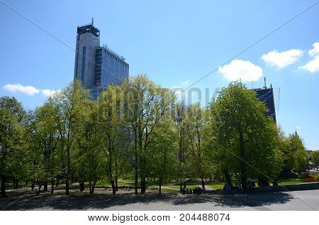 Katowice in Poland, skyscraper against the sky and trees