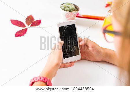 Girl Using Phone With Broken Screen