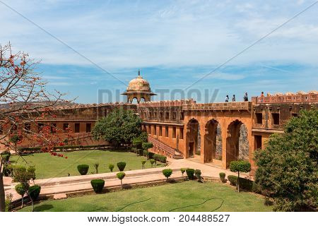 JAIPUR RAJASTHAN INDIA - MARCH 11 2016: Horizontal picture of the courtyard with trees at Jaigarh Fort on the top of the mountains of Jaipur known as pink city in India.