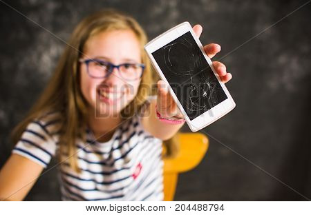 Girl Showing A Phone With Broken Screen