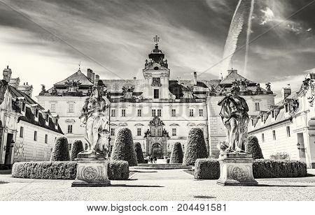 Valtice contains one of the most impressive baroque residences of central Europe. Architectural scene. Travel destination. Black and white photo.