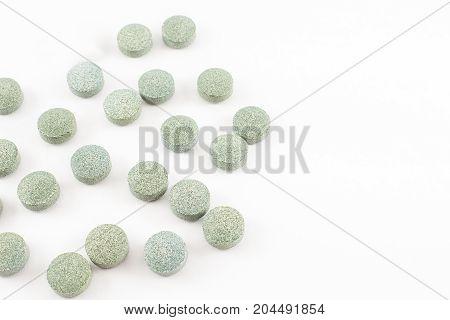 Spirulina pills vitamine B12. White background. Isolated