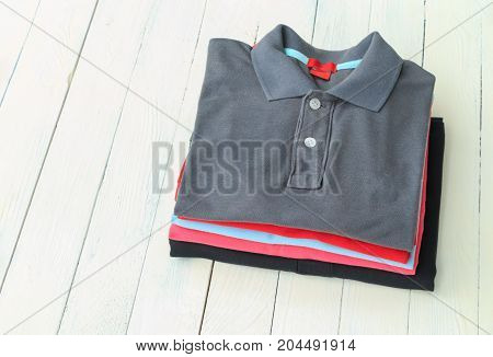 Polo shirts put on white wooden table top background