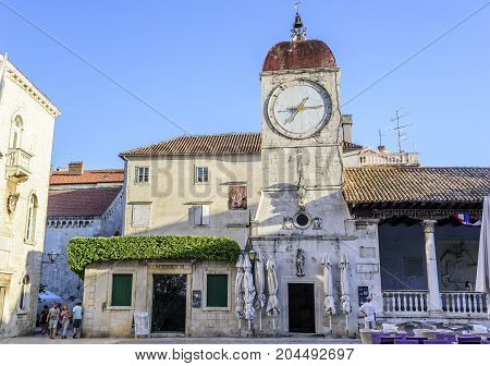 TROGIR, CROATIA - 11 JULY, 2017: Clock on the tower of the main square of Trogir., a popular tourist destination in Croatia.