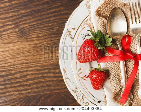Tableware And Silverware With Ripe Strawberries