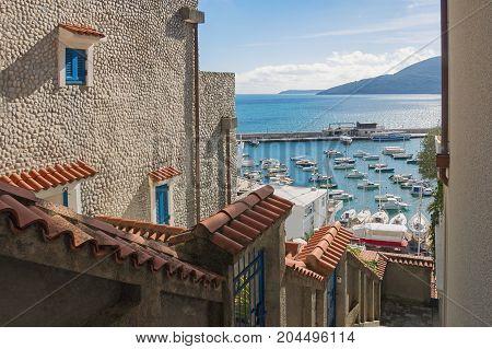 Narrow passage between buildings. Gerceg Novi town, Montenegro