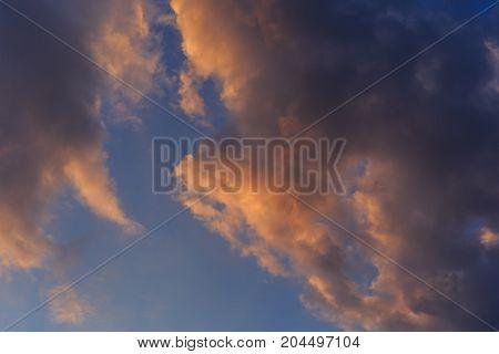 Dramatic sunset clouds background, sunrise sky, toned