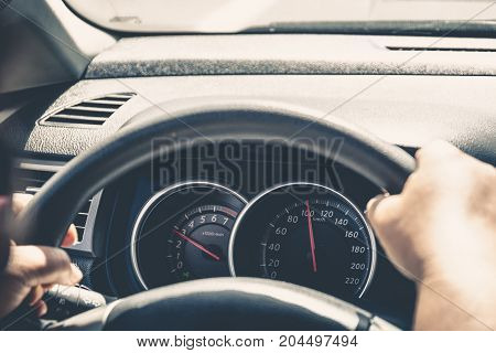 Speedometer of the car at a speed of 100 kilometers per hour, selective focus, toned