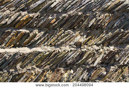 One of the original wall masonry samples or the fence in Devon. Woolacombe. England