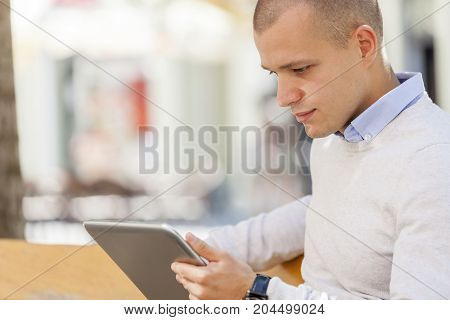 Portrait Of A Successful Businessman Using A Digital Tablet