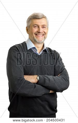 Joyful mature man crossed arms. Smiling elderly entrepreneur crossed his arms on white background. Positive emotions and feelings.