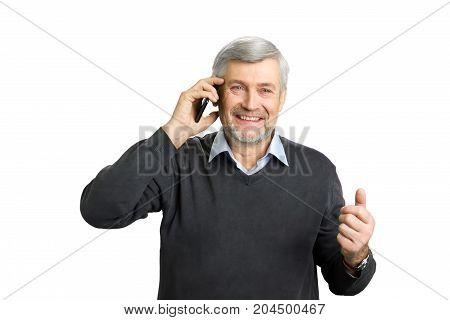 Excited mature man talking on phone. Beautiful elderly man talking on phone with great excitement. Expression of positive feelings and good news.
