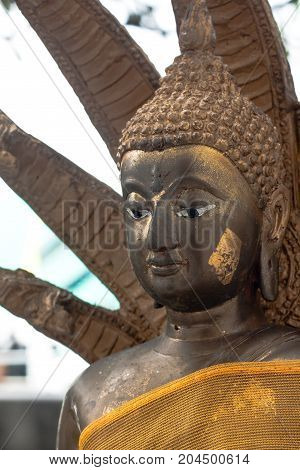 Golden Buddha statue with Naka cover pose closeup Thailand