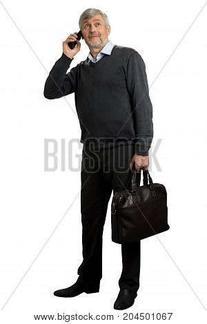 Mature man speaking on phone. Senior man speaking on phone on white background. Grey hair man holding black case.