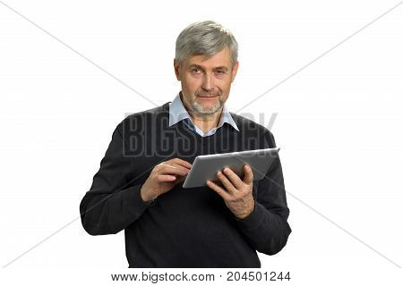 Portrait of mature man with pc tablet. Serious grey hair man holding computer tablet on white background close up. Senior man with digital tablet thinking on white background.