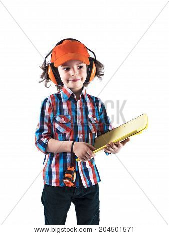 Little Curly Boy Builder In A Orange Cap Holds A Workbook And Roulette . White Background