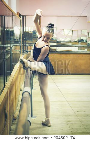 Young ballerina in the hall for rehearsals. Ballet. Creation. Dancing