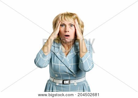 Portrait of frustrated mature woman. Horrified astonished woman looking shocked on white background.