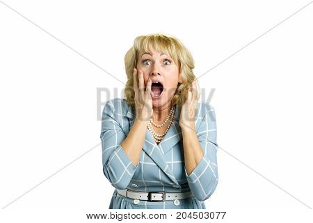 Surprise astonished middle aged woman. Surprise astonished white-skin woman. Close up portrait of mature woman looking surprised in full disbelief with open mouth and hands near face.
